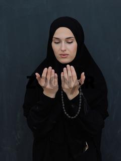 Portrait of young Muslim woman making dua