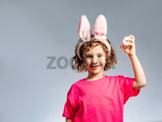 the girl with bunny ears demonstrates the symbol of Easter