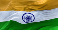 Detail of the national flag of India flying in the wind.