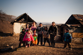 SEREDNIE, UKRAINE - MARCH 09, 2011: kids are happy not paying attention to surrounding poorness