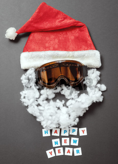 Red velvet hat with snow mask and cotton mustache and beard. Cheerful New Year card