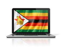 Zimbabwe flag on laptop screen isolated on white. 3D illustration
