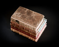 Stack of old books on black background