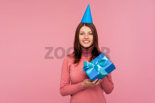 Portrait of emotional brunette young woman on pink background.