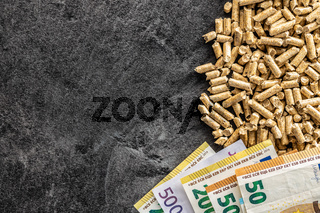 Wooden pellets and euro banknotes. Ecological heating.