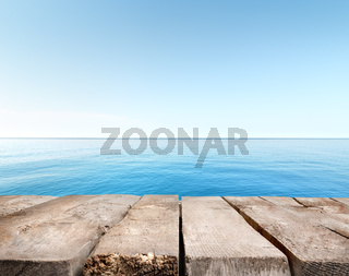 Blue sea and wooden pier