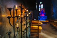 Selective focus on votive lit candle on candelabra in St Marys Cathedral