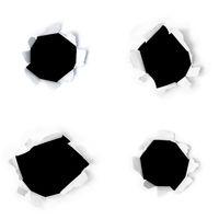 Vier in Papier gerissene Löcher als Design Elemente