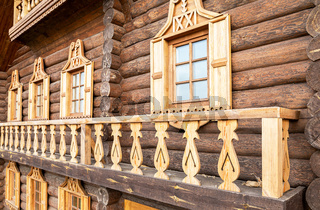 Windows of wooden house decorated with wooden carvings