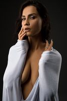 Sensual woman in white cloth looking at camera