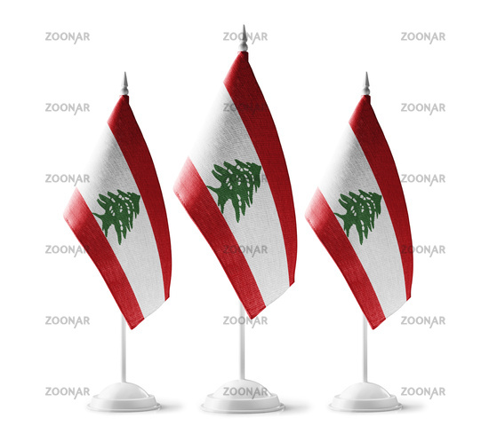 Small national flags of the Lebanon on a white background