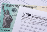 US Treasury check for stimulus in 2020 against a USA Form 1040