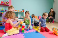 Kids playing together on a colorful mats