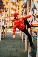 Boy strengthens his body climbing on outdoor playground