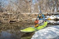 launching inflatable whitewater kayak