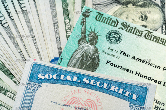 Illustration of the 2021 federal stimulus check from the IRS with cash and social security card