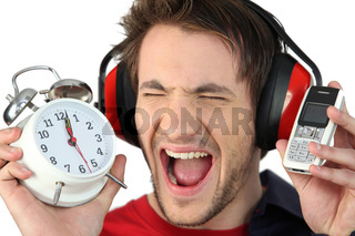 Man screaming at his alarm clock
