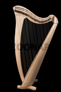 Classical wooden harp isolated on black background