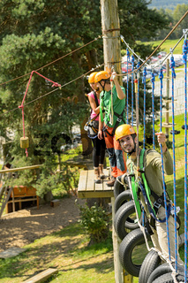 Climbing visitors in adventure park