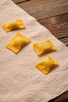 Raw homemade ravioli pasta with spinach and ricotta
