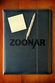 Executive Folder with note and pen