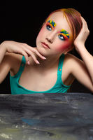 Teenager girl portrait with unusual face art make-up.