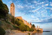 Rab is a Croatian island in the Adriatic Sea, old town encircled by ancient walls. The town's 4 prominent church bell towers include the Romanesque tower at the Cathedral Svete Marije (St. Mary)
