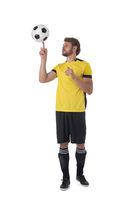 Soccer player spinning ball on finger