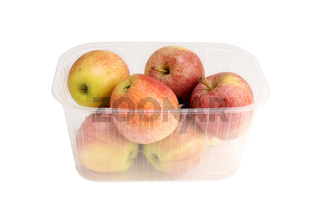 Apples in a plastic box isolated on white background