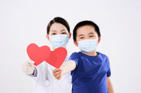 A woman doctor and a little boy each had a red heart