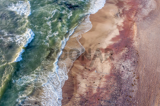 Birds eye view of the red colored sandy beach in Swakopmund, Namibia