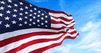 close up view of the american flag waving in the wind.