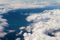 Airplane view on clouds and sea
