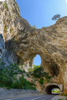 Road and tunnel at Piva Lake in national park Dormitor of Montenegro at summer