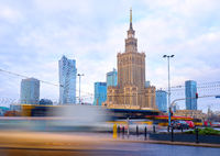 High traffic near the Palace of Culture and Science in Warsaw, Poland. Long exposure shot of city life. Business center cityscape.