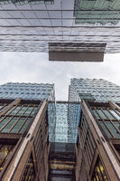 Bottom view of modern skyscrapers made of glass and metal in Moscow