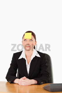 Businesswoman looking at the sign on her forehead