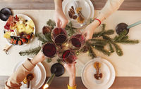 Crop people proposing toast over Christmas table