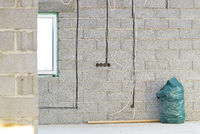 laying of electrics and other engineering systems in a stone wall in a private house being built