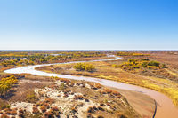 aerial view of the winding river and flood land in autumn