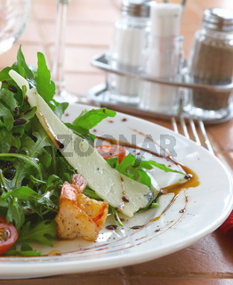 Fresh salad with a tomato, cheese and the fried meat