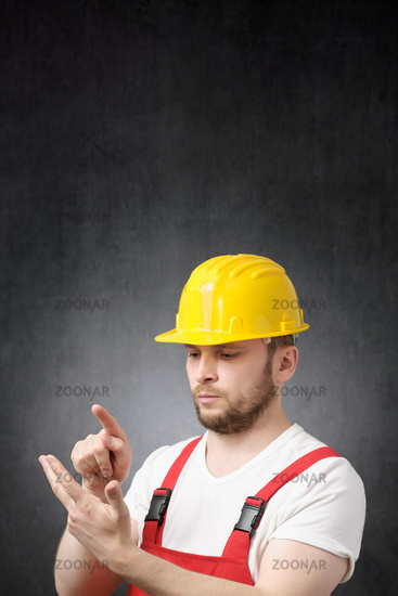 Portrait of a counting construction worker