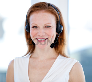 Caucasian sales representative woman with an headset