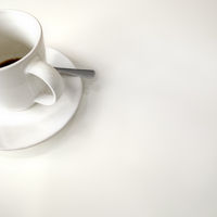 finished cup of coffe white background
