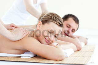 Affectionate couple having a back massage with closed eyes