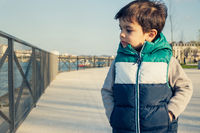 Little boy wearing sleeveless jacket