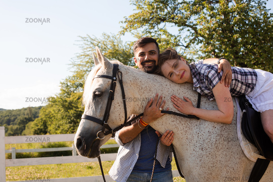The young woman spends time with her favorite horse