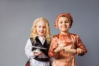 Kids pose in the costumes of a waiter and a cook