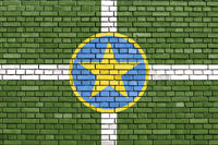 flag of Jackson, Mississippi painted on brick wall