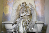 Statue of angel on an old tomb located in Genoa cemetery - Italy